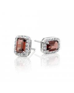 4mm x 6mm Garnet and 0.15ct diamond stud earrings in 9K white gold