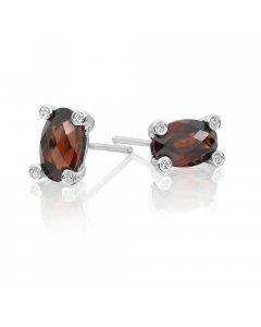 5mm x 8mm Garnet and 0.05ct diamond stud earrings in 9K white gold