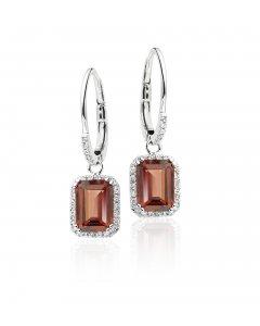 5mm x 7mm Garnet and 0.20ct diamond earrings in 9K white gold